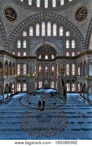 Istanbul, Turkey - April 20, 2017: Interior of Nuruosmaniye Mosque, an Ottoman Baroque style mosque completed in 1755, with a huge dome & many colored stained glass windows, Fatih, Istanbul, Turkey