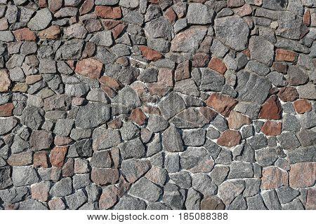 Rubble gray stone wall rubble work .