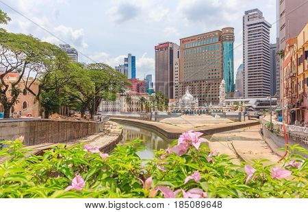 KUALA LUMPUR, MALAYSIA - APRIL 14, 2016: Historic mosque of Masjid Jamek It's built in 1909 and one of the oldest mosques in Kuala Lumpur located at the confluence of the Klang and Gombak River on April 14 2016.
