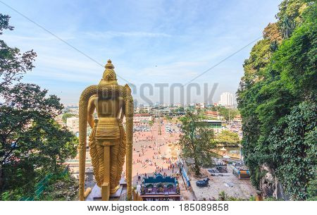 The Batu Caves Lord Murugan Statue and entrance near Kuala Lumpur Malaysia. A limestone outcrop located just north of Kuala Lumpur Batu Caves has three main caves featuring temples and Hindu shrines.