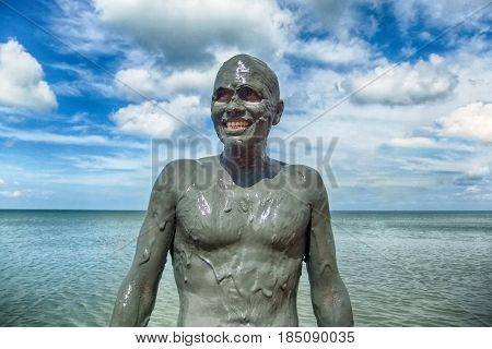 the mage man in the mud a Sunny day at sea