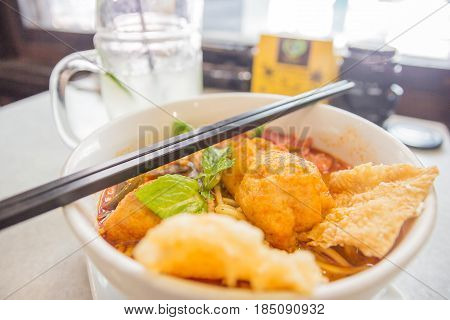 Curry Laksa(Curry Mee) which is a popular traditional spicy noodle soup from the Peranakan culture in Malaysia and Singapore