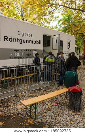 BERLIN - OCTOBER 30 2015: Centre for the reception and registration of refugees - LaGeSo. The queue of people in the mobile X-ray vehicle.