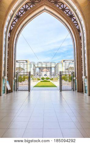 PUTRAJAYA, MALAYSIA - AUGUST 15, 2016: Entrance of Masjid Tuanku Mizan Zainal Abidin mosque can see the Palace of justice at putrajaya Malaysia.