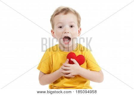 Smiling boy holding a red heart figurine. symbol of love family hope. Concept preservation of the family and children. Isolated white.