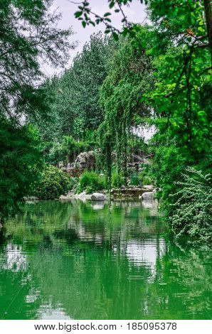 Landscapes from a wonderful garden in Isfahan, Iran  The beauty of nature in Isfahan city  , Iran  with a small lake