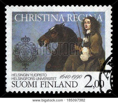 FINLAND - CIRCA 1990: a stamp printed in Finland shows Queen Christina of Sweden on horseback, university founder and patron, 350 years University of Helsinki, circa 1990