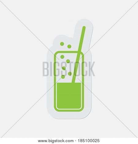 simple green icon with light gray contour and shadow - glass with carbonated drink and straw on a white background