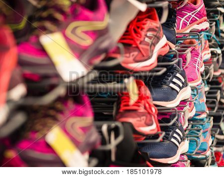 Verona Italy - March 19 2017: Background made of running shoes exhibited at a sporting goods store.