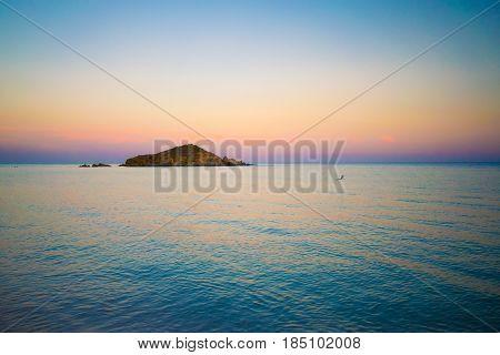 Su Giudeu island at sunset Chia Sardinia Italy.