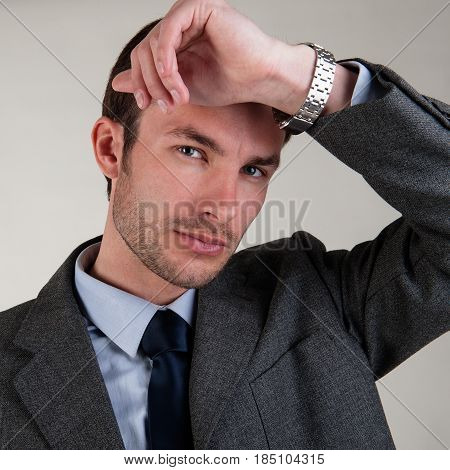 Business businessman bending his hand thoughtful on light background
