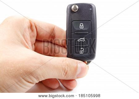 Man holds in hands ignition key with immobilizer