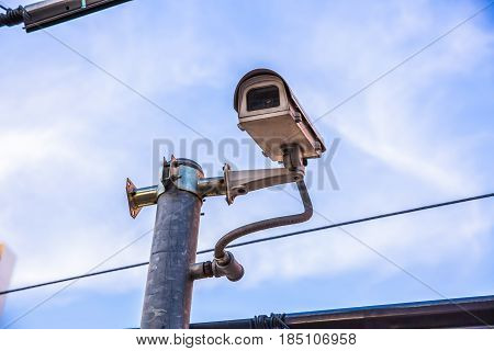 CCTV security camera with blue sky background.