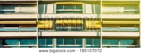 Vide image panoramic of row of Balconies with awning opened - covered by sun-shield on a warm summer day