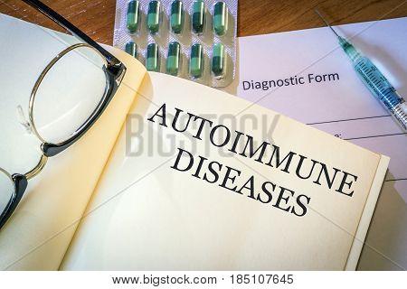 Book with diagnosis autoimmune diseases. Medic concept