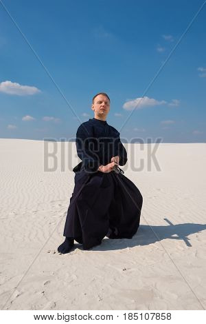 Concentrated Man In Traditional Japanese Clothes Took The Position