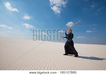 Man With Shinai In Traditional Japanese Clothes. Wide Angle
