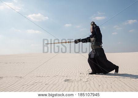 Warrior In Traditional Armor For Kendo - Bogu , Makes A Swift Attack