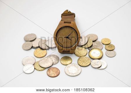 Wooden Watch Putting On Various Sizes Coin Stack With White Background,this Image For Money Saving A
