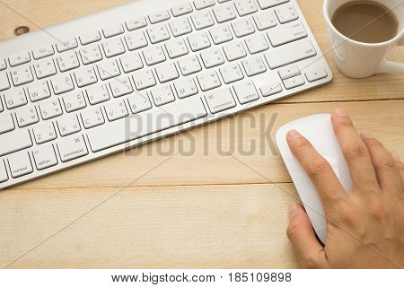 Top View. Hand Of Young Woman Using Mouse And Have Coffee Cup With Coffee Putting Beside Keyboard. W