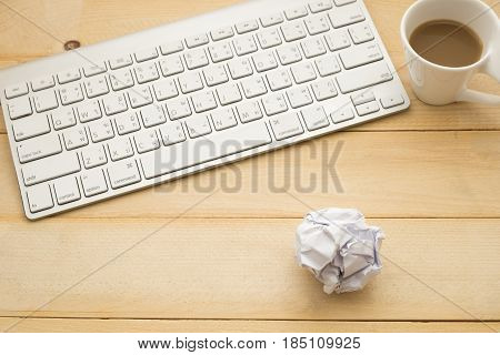 Top View. Coffee Cup With Coffee Putting On Beside Keyboard And Have Paper On Wooden Background. Thi