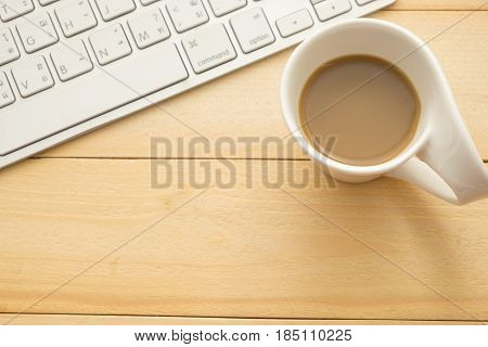 Top View. Coffee Glass With Coffee Putting Besidd Keyboard All Of This On Wooden Background. This Im