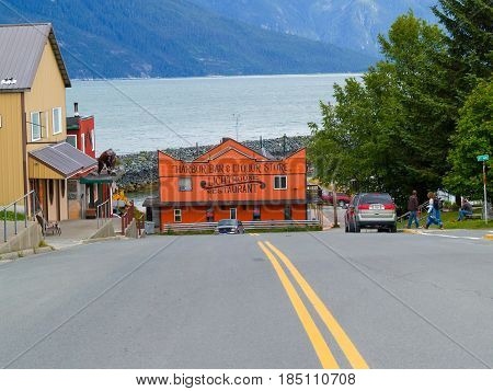 Haines Usa - July 31, 2008; Yellow lines down center of downhill road to buildings and restaurant in tourist small town Haines in Alsaka on edge of Chilkoot Inlet Alaska.