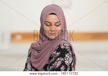 Muslim Woman Is Praying In The Mosque
