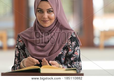 Muslim Woman Is Reading The Quran