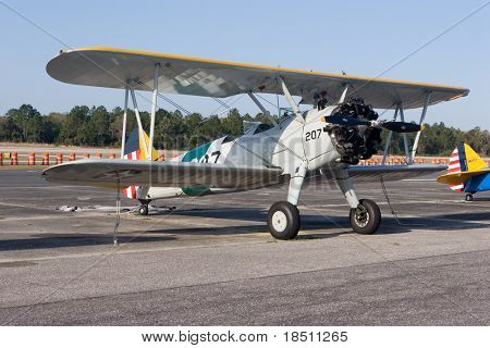PALM COAST, FLORIDA - MARCH 27: A Bi-plane is on display at the Wings Over Flagler Air Show at the Flagler County Airport on March 27, 2010 in Palm Coast, Florida.