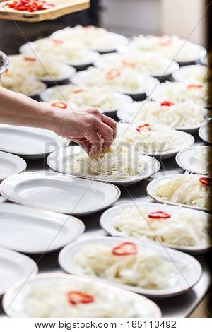 Chopped Cabbage In A White Plates