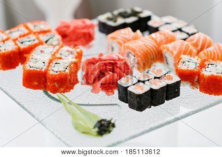 Japanese Cuisine -Buffet catering style Sushi Set in restaurant - salmon Maki Sushi and Nigiri Sushi