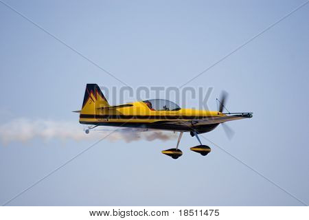 PALM COAST, FLORIDA - MARCH 27: A Stunt Plane flies at the Wings Over Flagler Air Show at the Flagler County Airport on March 27, 2010 in Palm Coast, Florida.