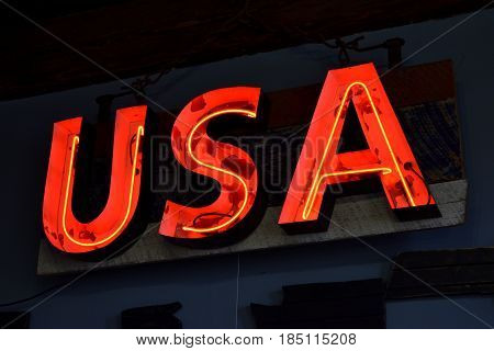 USA neon light background at a store front.