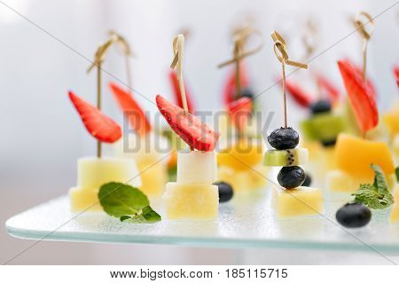 Appetizers, gourmet food - canape with cheese and strawberries, catering service