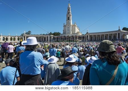 Fatima Portugal - May 13 2014: Crowd of people at the Sanctuary of Fatima during the celebrations of the apparition of the Virgin Mary in Fatima Portugal.