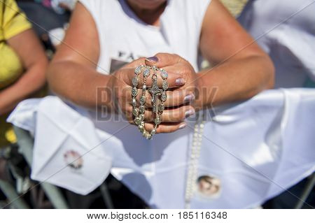 Fatima Portugal - May 13 2014: Detail of a woman holding a rosary at the Sanctuary of Fatima during the celebrations of the apparition of the Virgin Mary in Fatima Portugal.