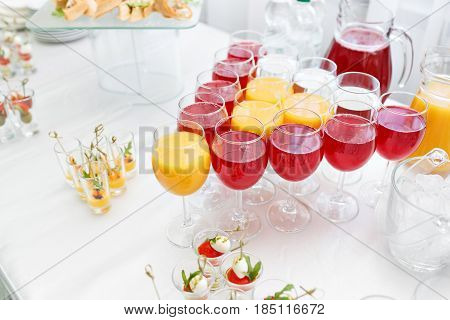Restaurant Cocktail Tables in the Cocktail party. ice in a transparent glass bowl and metal sticking. festive buffet, alcoholic and alcohol free drinks