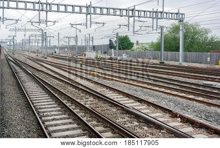 Newly installed overhead live wires on the upgraded Great Western mainline at Reading in Berkshire, UK. Soon, new super express class 800 inter city trains will replace 40 year old diesel units.