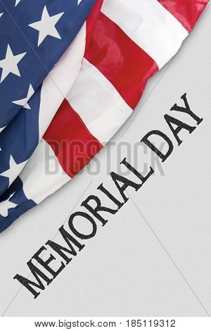 High angle view of a text of memorial day on the white background near an American flag