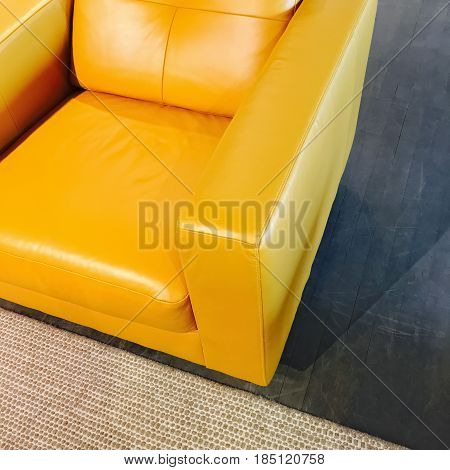 Bright yellow leather armchair. Stylish modern furniture.