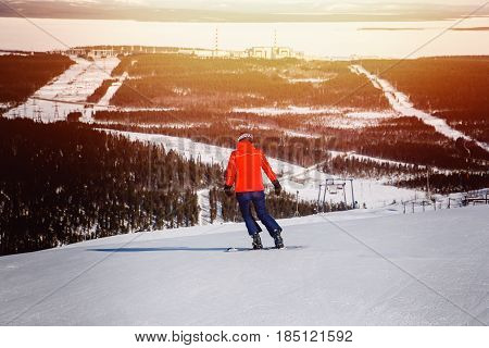 Athlete on a hard snowboard for slalom on the ski slope, Murmansk region, Russia.