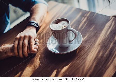 View Of Man Hand Holding A Cup Of Coffee , A Cup Of Coffee And A Man's Hand
