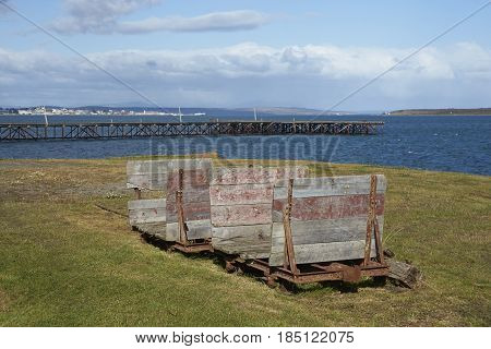 PUERTO NATALES, CHILE - APRIL 10, 2017: Historic railway cart at a former meat refrigeration plant that have been renovated and converted into a luxury hotel.