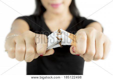 Female hand destroying cigarettes concept of refuse bad habit isolated on white background