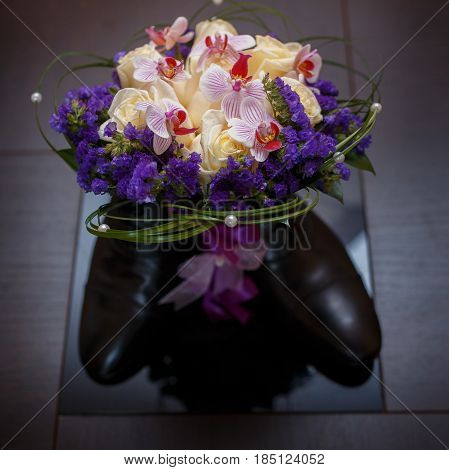 Wedding bouquet of orchids, roses, beads, Static purple. Wedding accessories of the bride.