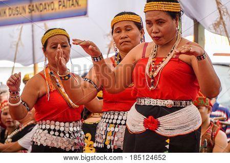 Penampang,Sabah-May 30,2016:Women of Sabah,Borneo Kadazandusun ethnic in their traditional costumes performs traditional dance during Harvest Festival at Penampang,Sabah,Malaysia