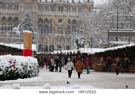 VIENNA, AUSTRIA-DEC 03: Store detectives at Christmas Markets in Austria are being disguised as the baby Jesus in an attempt to catch pick pockets.  The Vienna Christmas Market on December 3, 2010.