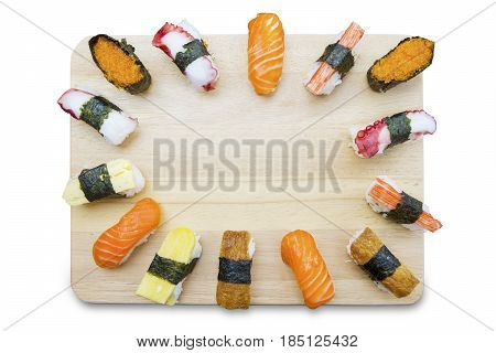 High angle view of variety Japanese sushi on the wooden plate isolated on white background