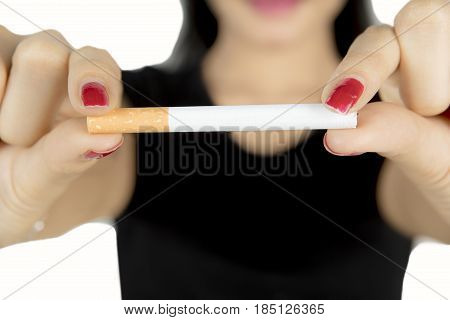 Woman hand holding and breaking a cigarette concept of healthy lifestyle isolated on white background